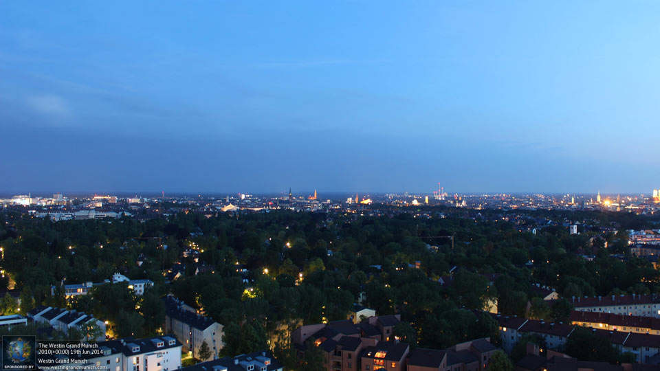 Late evening sets over a leafy Munich.